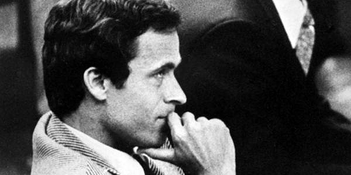 Ted Bundy in court with his hand pressed against his mouth and chin