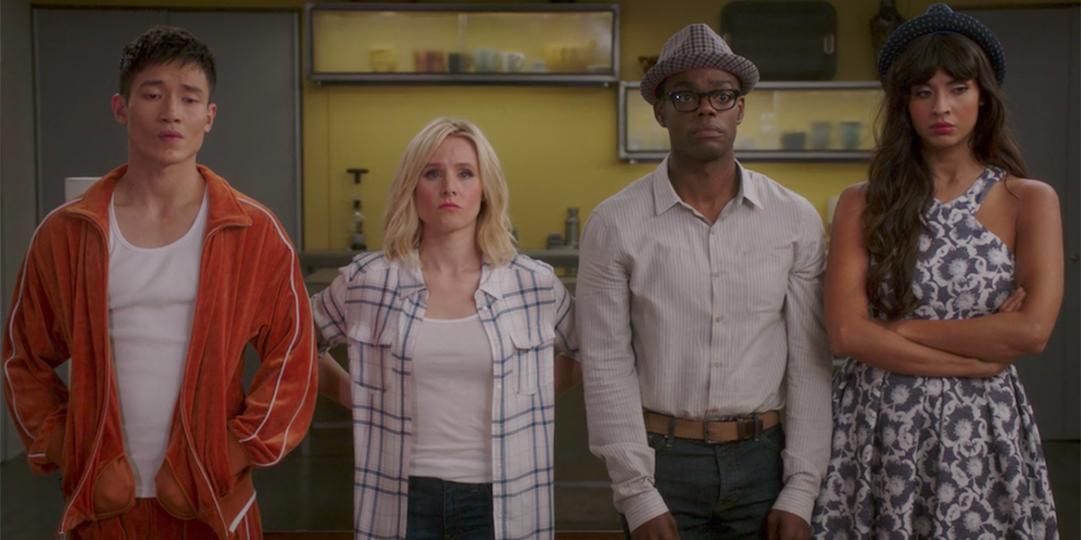 Manny Jacinto, Kristen Bell, William Jackson Harper, and Jameela Jamil stand shoulder to shoulder with worried expressions on their faces