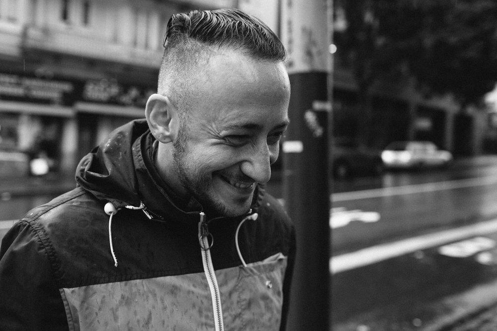 black and white photo of author Thomas Page McBee smiling