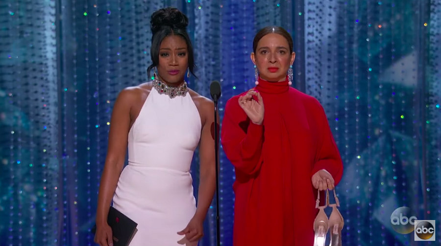 Tiffany Haddish and Maya Rudolph presenting an award at the 2018 Oscars