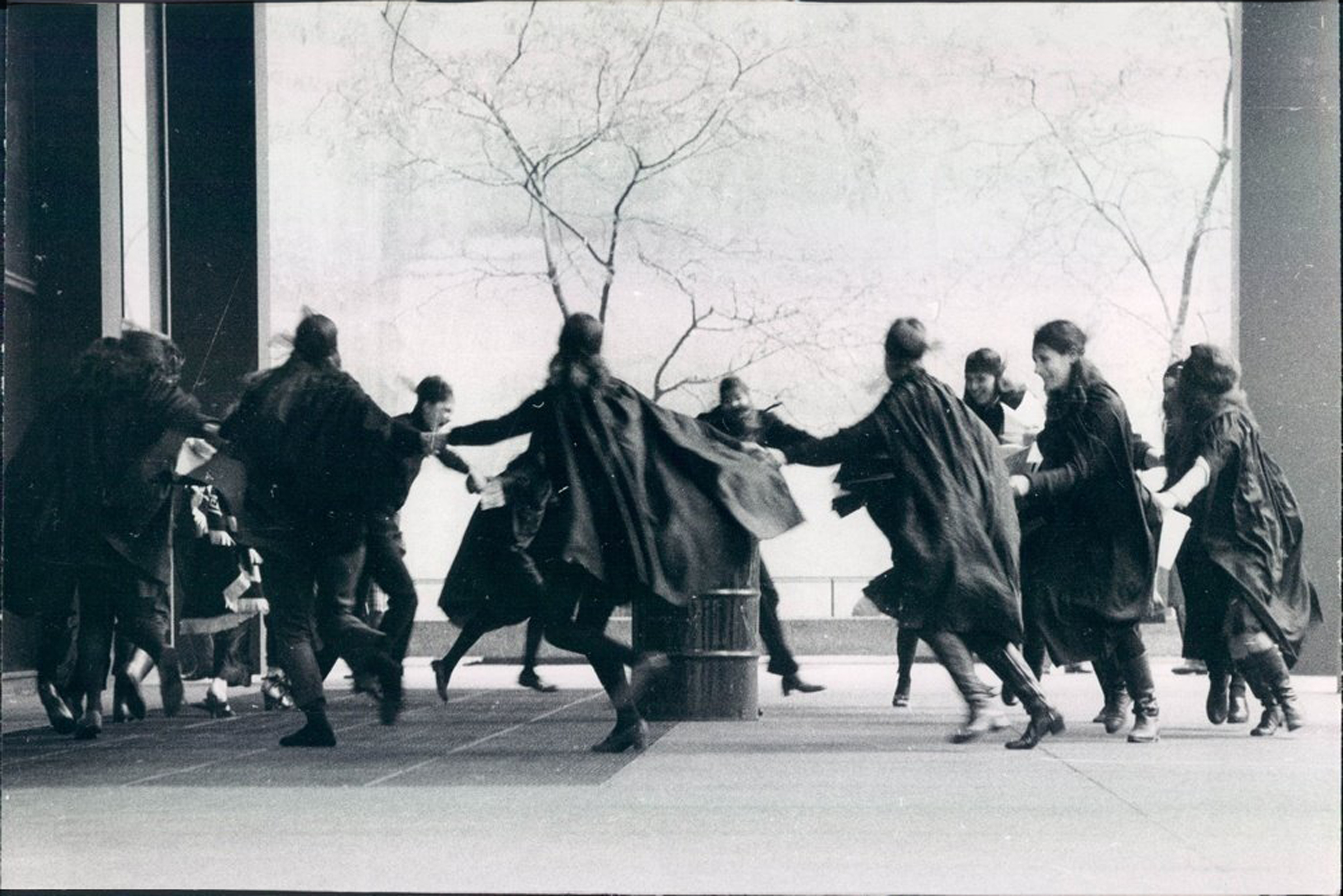 a group of witches dance together in a black and white photo