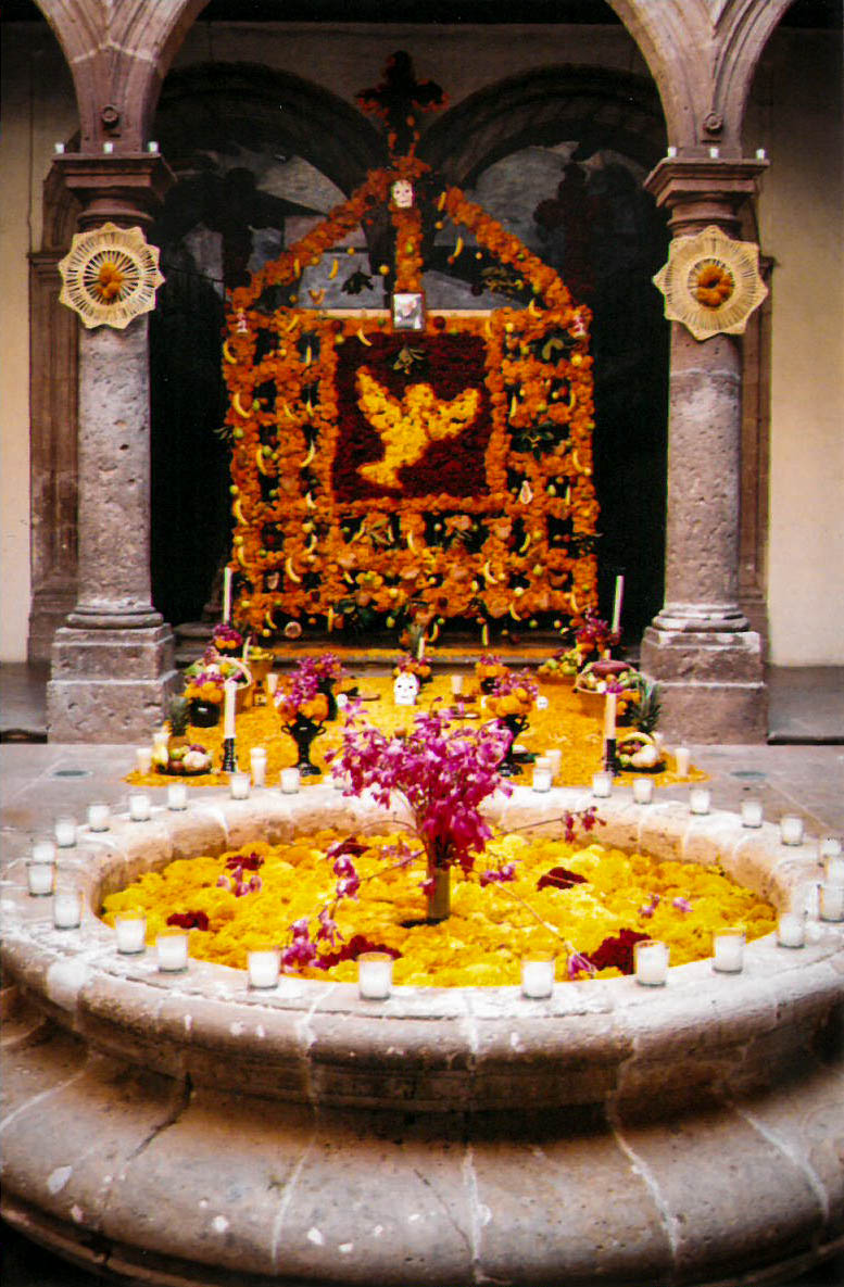 an elaborate altar filled and decorated with marigolds