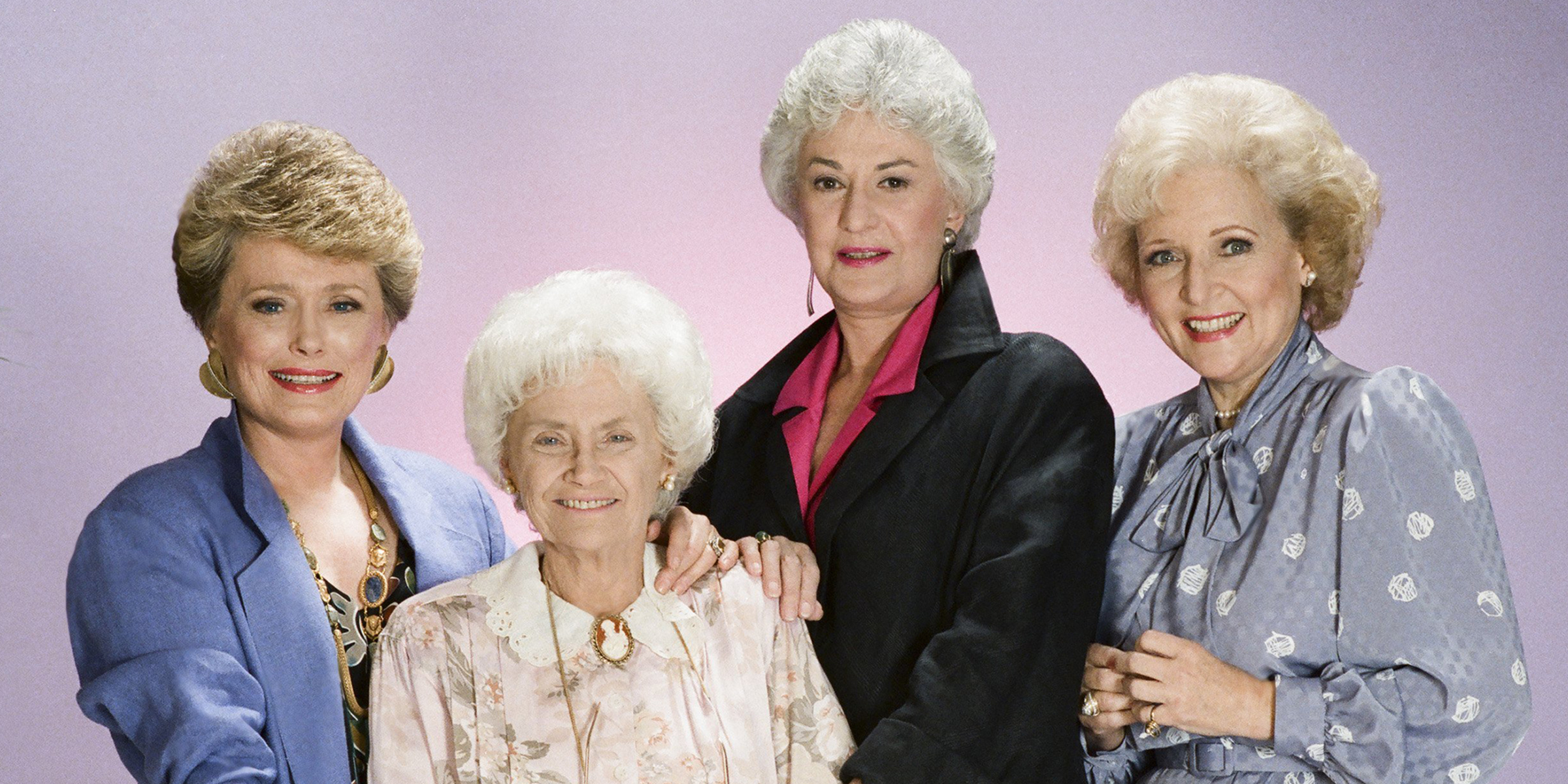 four older white women standing in front a purple background on The Golden Girls