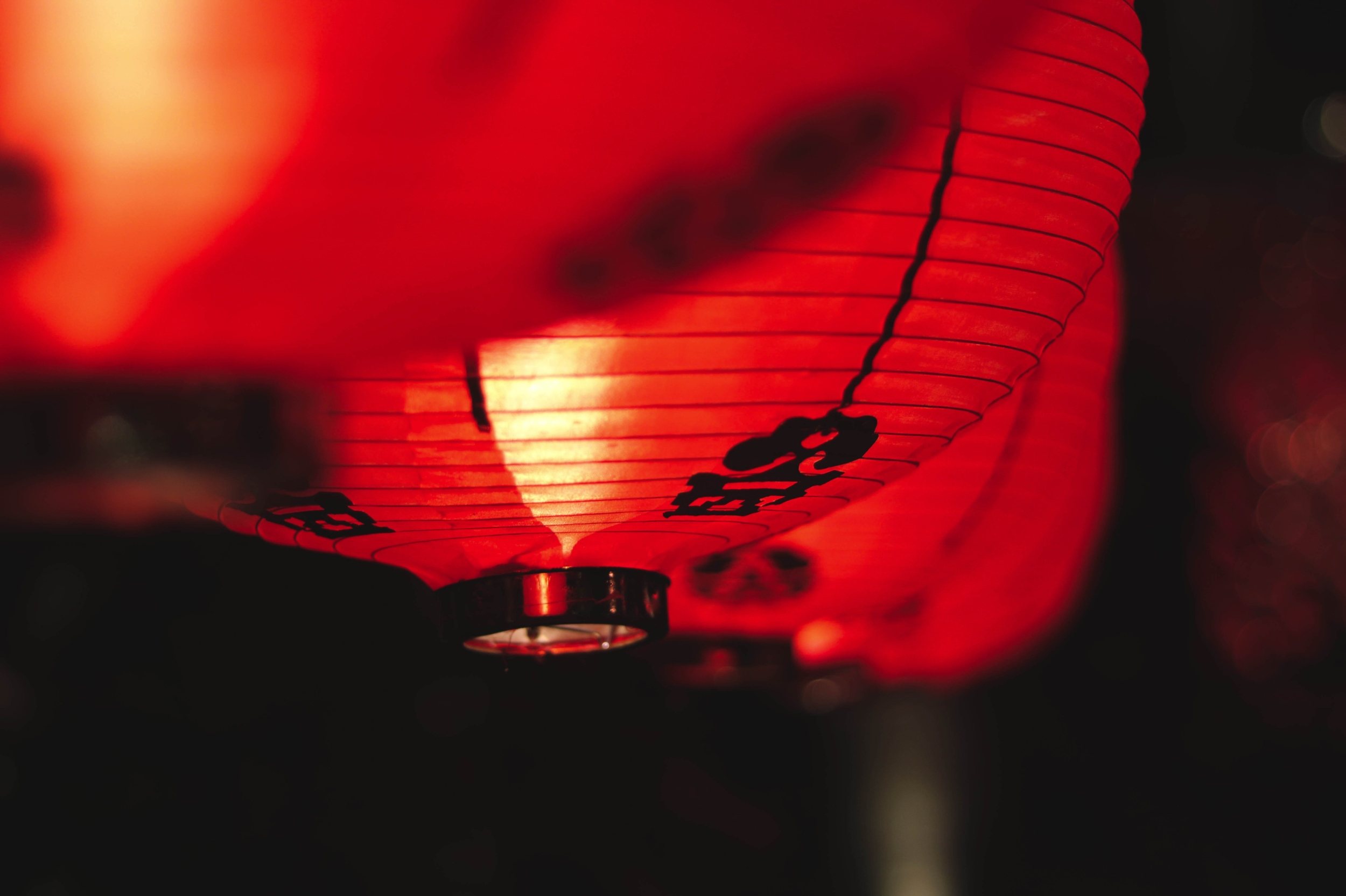 A red, glowing lantern in Thailand.