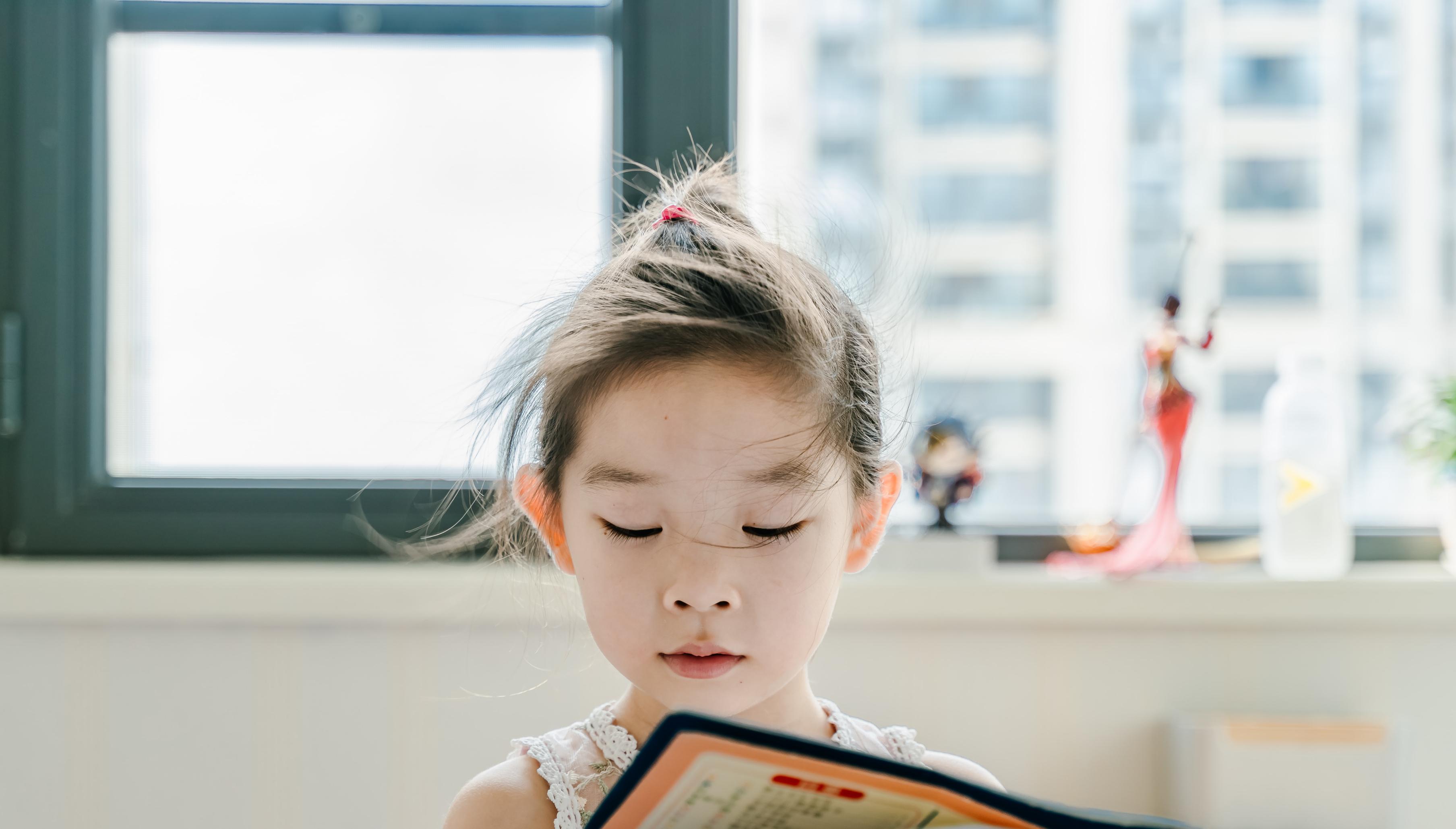 A child reads a book.