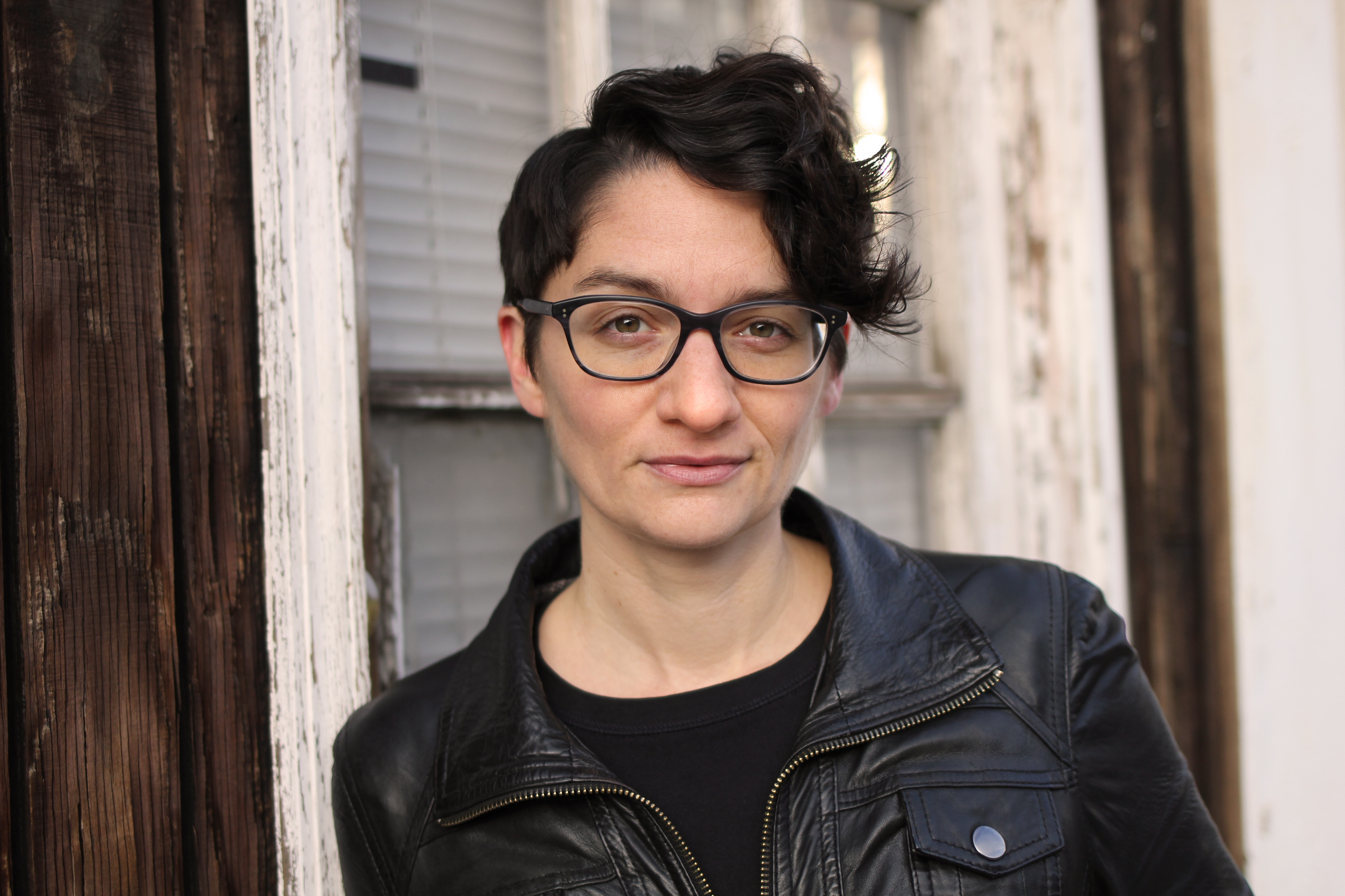 Tomboyland author Melissa Faliveno, who is white with short, dark hair and glasses.