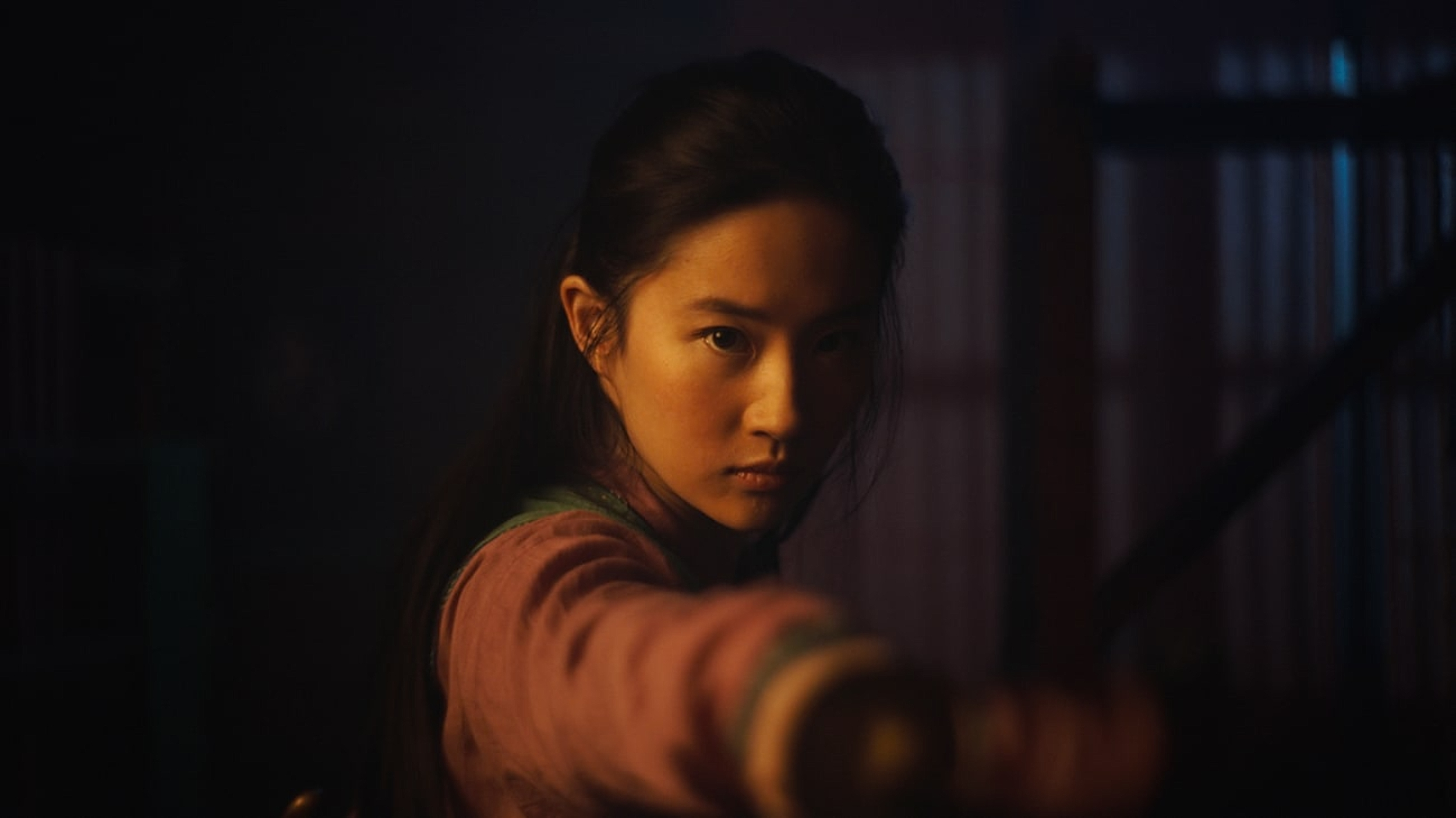 Liu Yifei as Mulan, a Chinese young woman, who wears red and has long, dark hair.