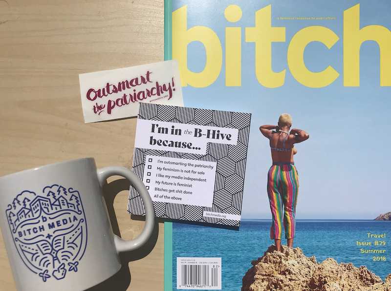 An image of Bitch magazine, a mug, and an Outsmart the Patriarchy sticker