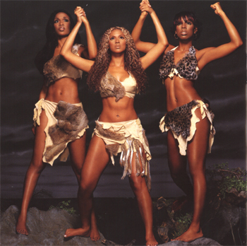 the girls of Destiny's Child in their Survivor outfits. they are standing with their arms raised, holding hands in solidarity