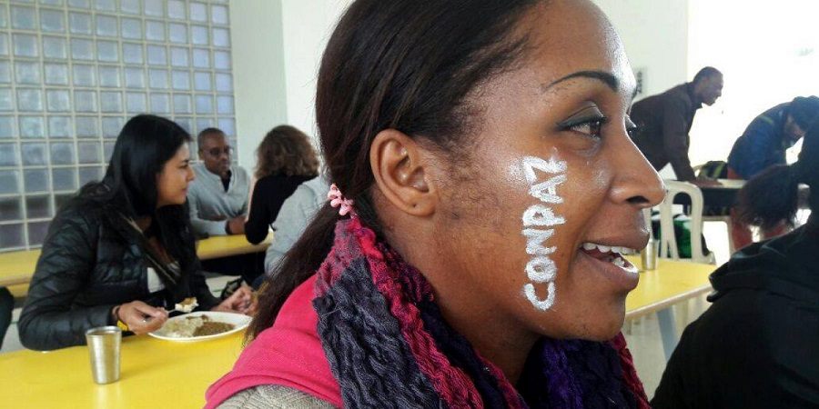 "Afro-Colombian human rights activist Emilsen Manyoma with ""CONPAZ"" painting on her cheek"