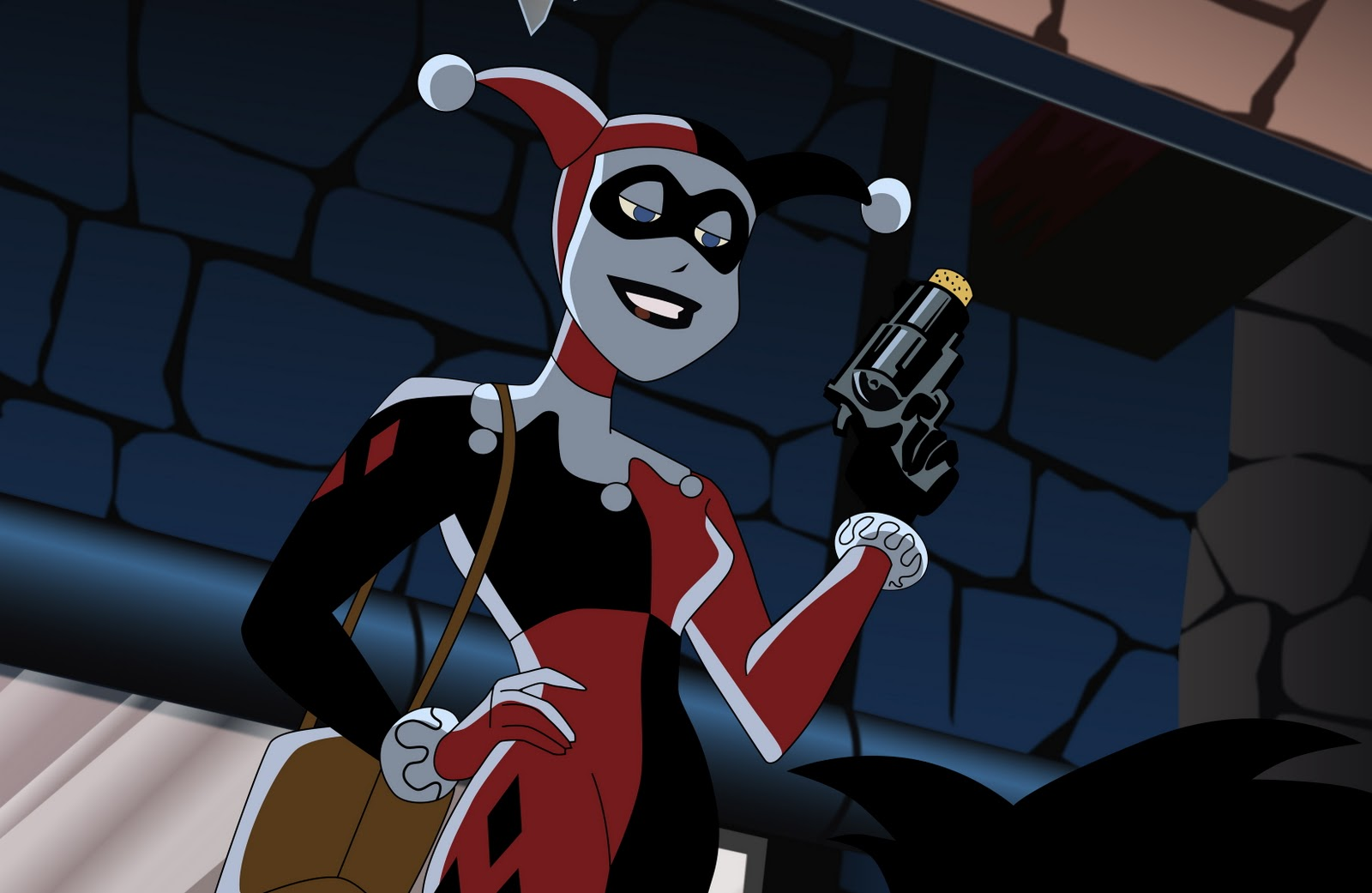 Harley in Batman the Animated Series had a red and black unitard and jester hat.