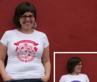 Model wears a white tee with red logo (inset is white with grape).