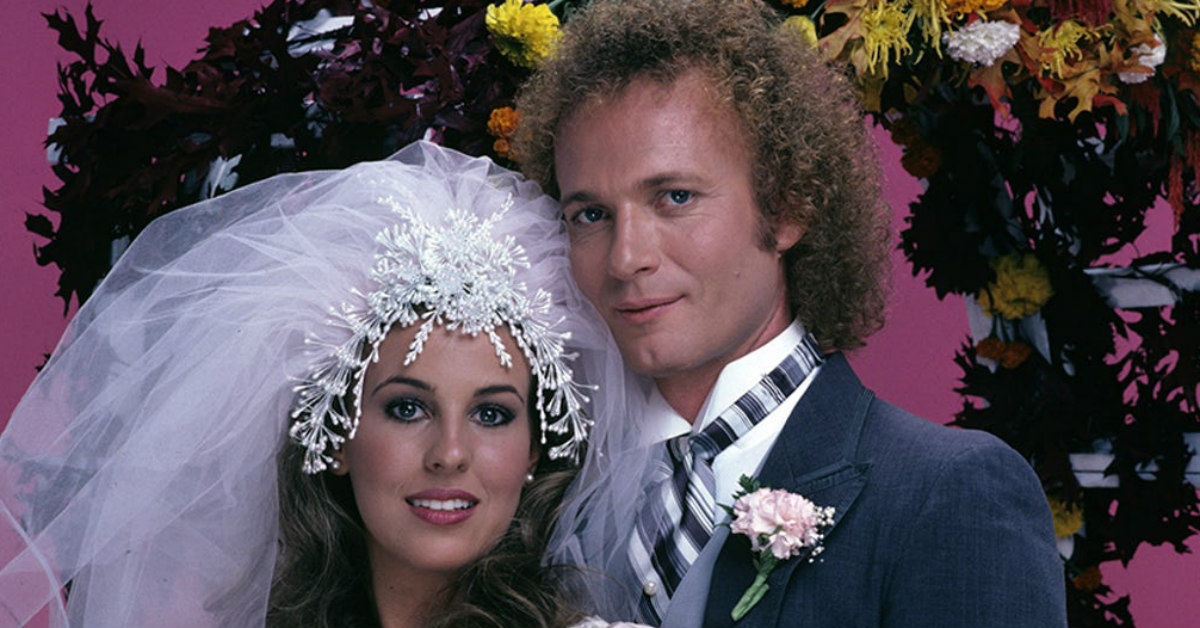 Luke and Laura, a white couple on General Hospital, pose for the camera during their wedding