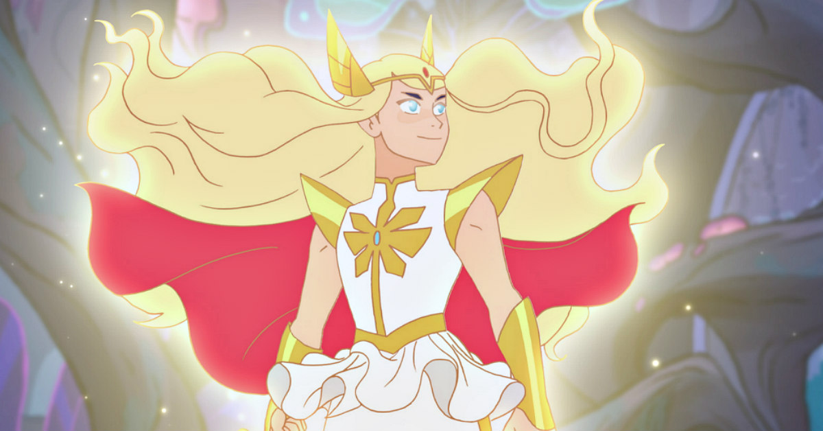 a white cartoon with blonde hair, red cape, and crown