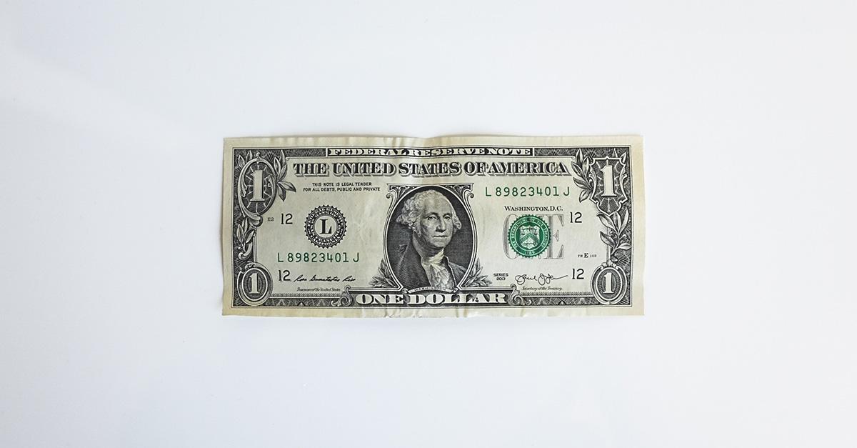 A U.S. $1 bill against a white background