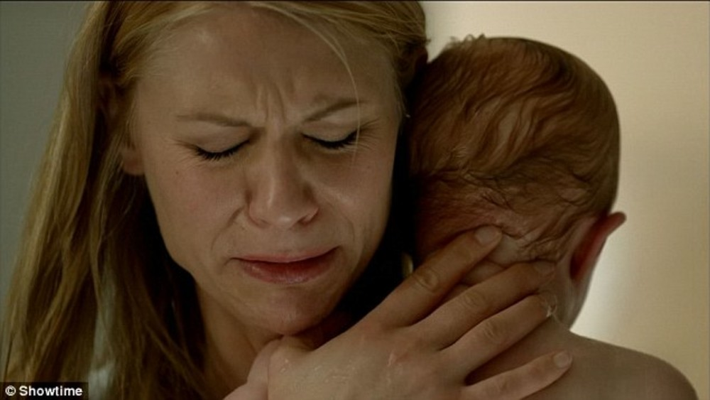 A photo of Clare Danes on Homeland clutching her baby to her chest