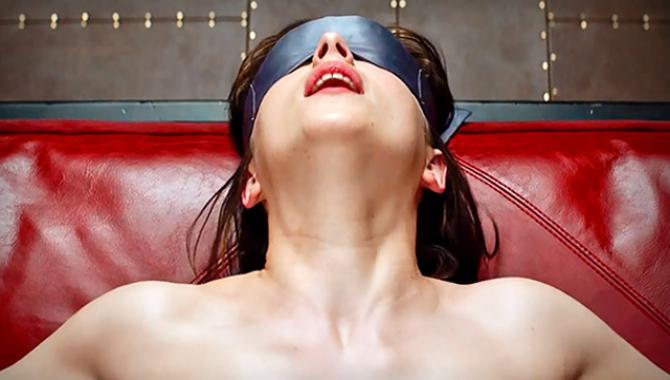 ana tied up with a blindfold over her eyes in 50 shades