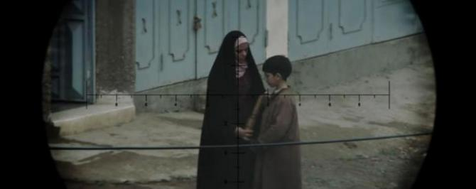 A woman and child seen through the sniper's scope