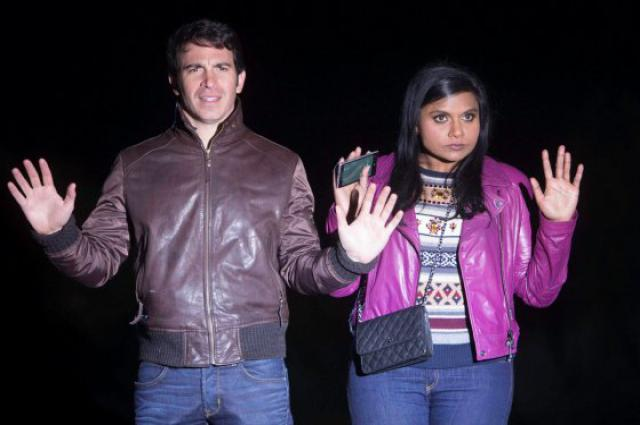 A still from the Mindy Project where the main characters are stopped in police headlights