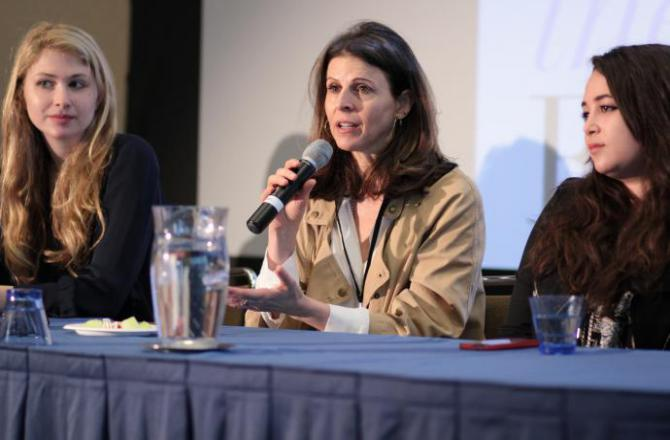 amy ziering, center, talks about her film The Hunting Ground