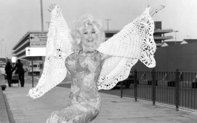 dolly parton, wearing a flamboyant pantsuit