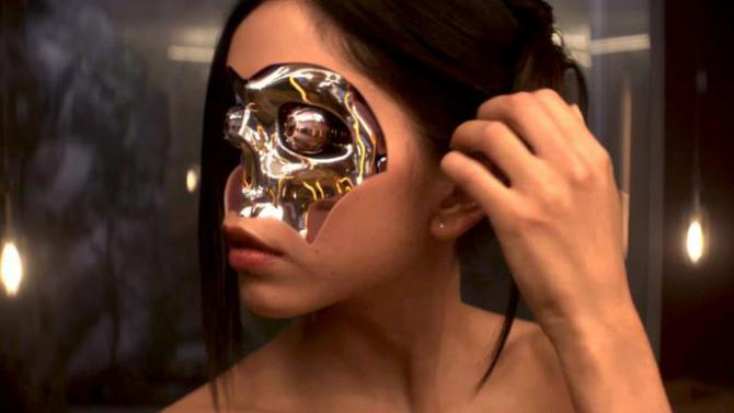 A shot of Kyoko with her frontal skin removed, showing her shiny robot innards