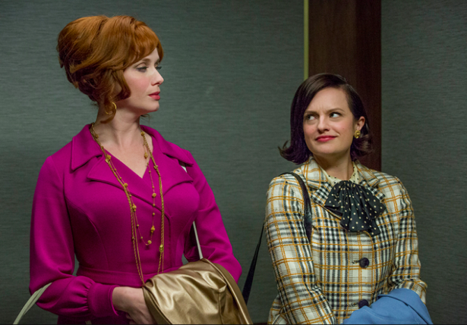 joan and peggy give each other the side-eye in an elevator