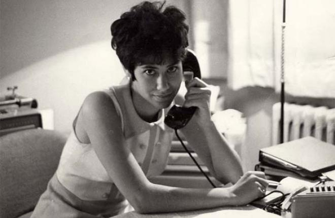 Lynn Povich, answering a phone at her desk in the 1970s