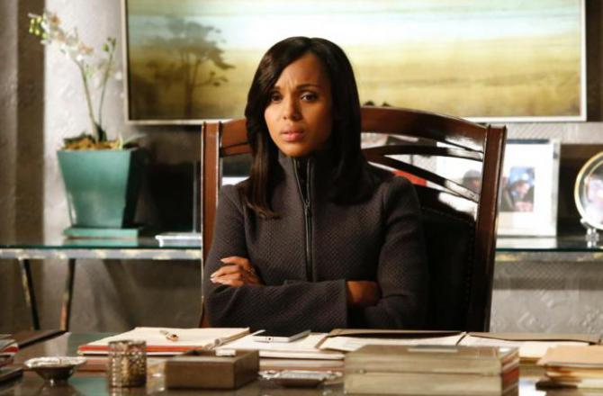 olivia pope at a desk, looking nervous