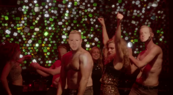 chastity belt dancing around guys with macklemore masks