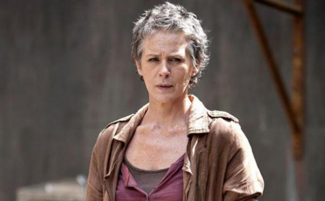 carol is an older white woman with short hair