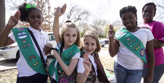 Girl Scouts holding up the Girl Scouts sign in a still from their Indiegogo campaign.