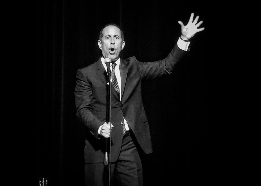 Comedian Jerry Seinfeld on stage.