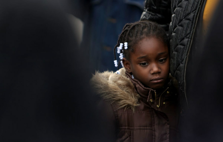 stock image of a black girl at a rally