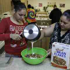 Hailey Wynos and Shardae Skenandore make a healthy snack as part of a cooking demonstration guided by the Menominee Tribe of Wisconsin