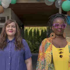 a white woman and a darkskinned Black woman walk into a plus-size pool party