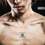 bare male torso with a small square device implanted below collarbone