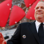 Harvey Weinstein, shot from a low angle, surrounded by bubbles