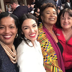 Six women of different styles, ages, and ethnicities smile and take a selfie together in the U.S. Capitol