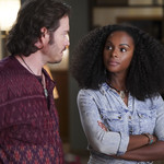Mark-Paul Gosselaar plays Paul, a white man wearing a burgundy flowy shirt, and Tika Sumpter plays Alicia, a Black woman in a jean shirt and a curly afro, in mixed-ish