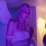 "A photo of Jules from ""Euphoria."" Jules is crying, her eye makeup smeared, and wearing an angel costume."