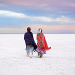 Photo of two Indigenous girls walking in snow