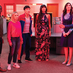 The cast of NBC's The Good Place in a red room in Season 3