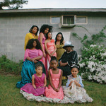 Black textile designer Jazsalyn McNeil and three generations of her family photographed together on her family's land