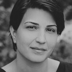 black and white portrait of Iranian author Nazanine Hozar, a shorthaired woman looking at the camera