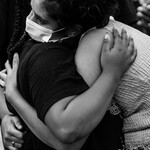 Thandiwe Abdullah, an organizer with Black Lives Matter and a cofounder of the Black Lives Matter Youth Vanguard, receives hugs after addressing the crowd