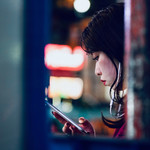 photo of an Asian woman checking her smartphone