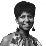 black and white photo of Black woman with short hair cut and smiling
