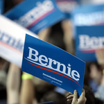 a photo of a blue Bernie Sanders for President sign at a rally