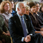 Joe Biden and Jill Biden, both old white people, sit in an audience of people.